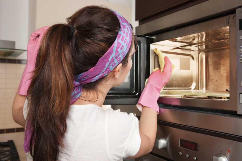 Woman%20cleaning%20microwave